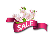 Sale Pink ribbon with flowers. Season discount banner design with cherry blossoms and petals. Royalty Free Stock Images