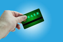 Sale plastic card in hand Stock Photo