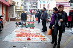 The sale of plastic flowers and Spring Festival couplets Stock Photography