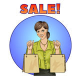 Sale pop art woman with shopping bags. Vector illustration Royalty Free Stock Image