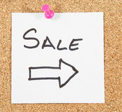 Sale post. On wooden background Royalty Free Stock Images