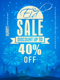 Sale poster, banner or template for Eid celebration. Beautiful Sale poster, banner or template design on blue fireworks and mosque silhouetted background for Stock Image