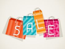 Sale poster with shopping bags in flat design Royalty Free Stock Image