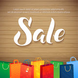 Sale Poster on Wood Background. Illustration of paper shopping bags and lights. Spesial Offer Royalty Free Stock Images