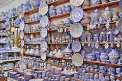 Sale of pottery decorated with Moroccan ornament in Marrakech. A lot of different dishes made of clay decorated with ornaments are sold on the market in royalty free stock photo