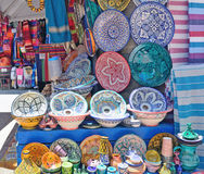 Sale of pottery decorated with Moroccan ornament in Marrakech. A lot of different dishes made of clay decorated with ornaments are sold on the market in stock photos