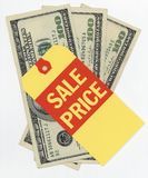 Sale Price on money. Sale price tag on hundred dollar bills stock image