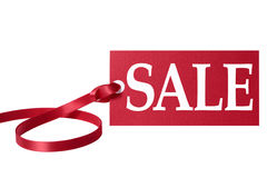 Sale price tag or label with red ribbon isolated on white. Royalty Free Stock Images