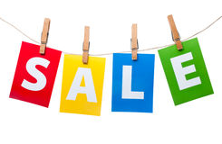 Sale price tag on line. Sale price tag signs hanging on line Stock Photo