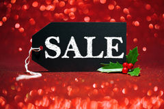 Sale price tag on red glitter Royalty Free Stock Image