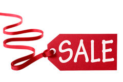 Sale price tag with red ribbon isolated on white. Royalty Free Stock Photos