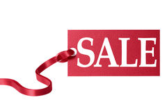 Sale price tag  or sign with red ribbon isolated on white. Royalty Free Stock Photography