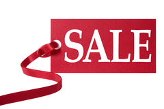 Sale price tag or ticket with red ribbon isolated on white background Royalty Free Stock Photography