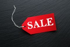 Sale price tags on dark slate. Background Stock Photography