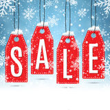 Sale price tags on winter background Royalty Free Stock Photo