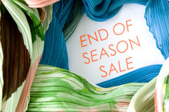 Sale promotion. Text End of season sale promotion around with colorful clothing Stock Images