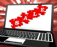 Sale Puzzle On Laptop Shows Price Discounts Royalty Free Stock Photography