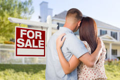 For Sale Real Estate Sign, Military Couple Looking at House Royalty Free Stock Image