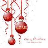 Sale on red Christmas ball Stock Photography