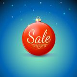 Sale, red Christmas ball over starry background. Royalty Free Stock Photo