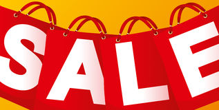 Sale on red packet. On a yello background Stock Image