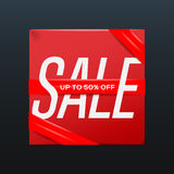 Sale red poster with ribbon up to 50 percent off on the box Stock Image