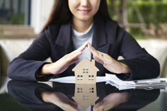 Sale represent real estate agent offer new house, document loan. Contract and insurance, success business contract deals stock photo