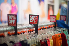Sale in the retail store. Sale on clothes in the retail store royalty free stock photos