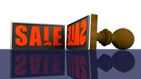 Sale Rubber stämpel som avspeglas på en reflekterande vägg Arkivfoto
