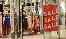Sale - Sale - Sale !. End of season sales at a clothing store Royalty Free Stock Images