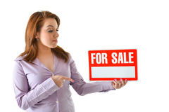 For Sale. Sales woman pointing at for sale sign to be filled in by user Stock Photos