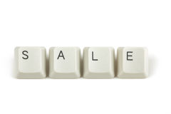 Sale from scattered keyboard keys on white Royalty Free Stock Photography