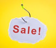 Sale! Scrap of paper on fishing hook. stock photos