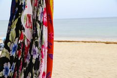 Sale of shawls and dresses. On the beach boutique stock photography