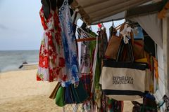 Sale of shawls and dresses. On the beach boutique stock images