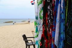 Sale of shawls and dresses. On the beach boutique royalty free stock photo