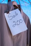 Sale shirt. With paper 200 bath Stock Image