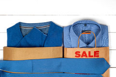 Sale with shoes and shirts Royalty Free Stock Photography