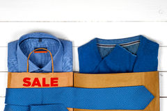 Sale with shoes and shirts Stock Images