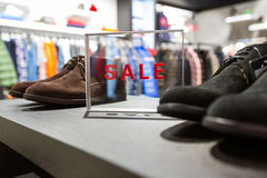 Sale in a shoes store Stock Image