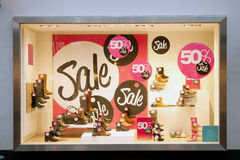 Sale in shop window of shoe shop. Sale signs in shop window of shoe shop Royalty Free Stock Image