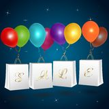 Sale shopping bags with balloons Royalty Free Stock Photos