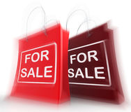 For Sale Shopping Bags Represent Retail Selling and Offers Royalty Free Stock Photo