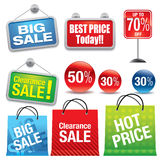 Sale shopping bags and signs Royalty Free Stock Photography