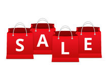 Sale on Shopping Bags. Word Sale on red shopping bags Royalty Free Stock Photo