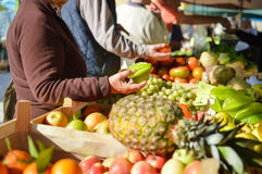 Sale, shopping, consumerism and pineapple in grocery market Stock Images