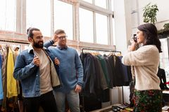 Friends photographing at vintage clothing store Royalty Free Stock Photography