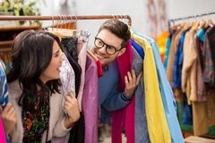 Happy couple having fun at vintage clothing store Royalty Free Stock Photos