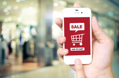 Sale and shopping on line concept on smart phone screen over blu Royalty Free Stock Photos