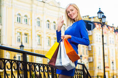 Sale, shopping, tourism and happy people concept - beautiful woman with shopping bags in the ctiy Stock Photography